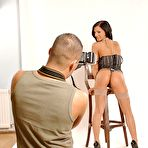 Fourth pic of Dark haired model Destiny in nylon stockings gives headjob to photographer