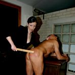 Second pic of Nude tan skin man gets his ass and cock spanked by clothed brunette domina Lady Nicole