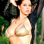 Second pic of Busty Gianna Michaels gets herself wet at the Pool 1 of 2