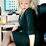 First pic of office boss flashes her nylons - Granny Lingerie