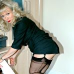 Second pic of office boss flashes her nylons - Granny Lingerie