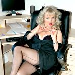 Third pic of office boss flashes her nylons - Granny Lingerie