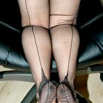 Fourth pic of office boss flashes her nylons - Granny Lingerie