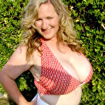 Third pic of Smiling huge titted middle aged fattie Seana Rae in top and skirt poses outdoors
