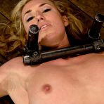 Second pic of Fair haired Slave Mason gets her feet and pussy punished in metal restraints.