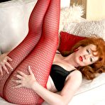 Fourth pic of Mature kinkster Red in red fishnet and sheer pantyhose! - Pantyhose Seduction