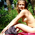 Second pic of Little Liza takes off all her clothes in the forest