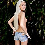 Second pic of Perky blonde takes off her denim shorts and see-through panties outdoors - IamXXX.com