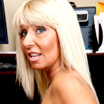 Fourth pic of Leggy MILF with stylish bangs shows her feet and anal fingering prowess - IamXXX.com