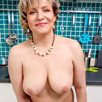 Third pic of Horny housewife Marianna shows off her big breasts -Granny Ladies