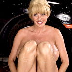 Second pic of Big titted MILF Penny Porsche is washing the car