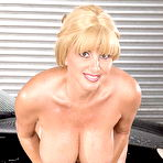 Fourth pic of Big titted MILF Penny Porsche is washing the car
