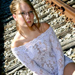 First pic of Amateur solo girl poss non nude on train tracks in tight dress and glasses