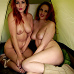 Fourth pic of Redhead lesbian girlfriends having fun in a tent